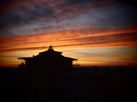Prague sunset in Pet iny city quarter. Silhouette of house japan style. Nice colors. Near airport. Banco de Imagens