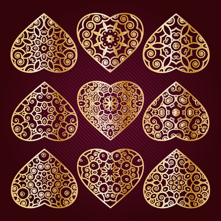 gilt: Gilt openwork hearts.  Hearts on Valentines Day. Valentines Day ornament for congratulations, cards, invitations, gifts.