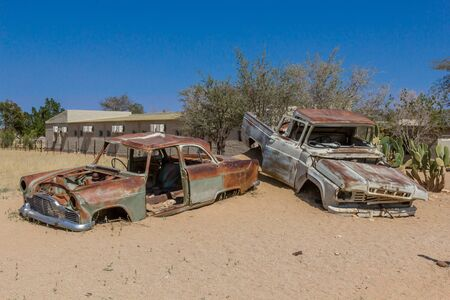 Abandoned rusted cars without doors in the desert of Solitaire, Namibia
