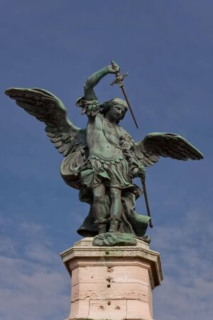 The bronze statue of Archangel Michael, standing on top of the castel SantAngelo, Rome, Italy photo