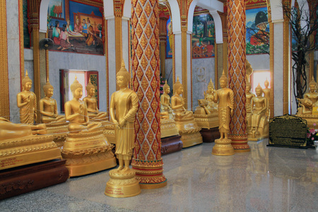 13 February 2019, Wat Chalong, Phuket, Thailand. Hall of initiation Wat Chalong or Wat Chantharam. Gold Buddha Statue. Editorial