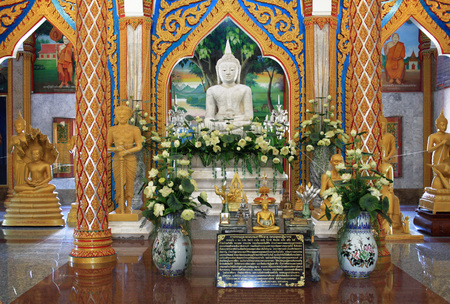 13 February 2019, Wat Chalong, Phuket, Thailand. Hall of initiation Wat Chalong or Wat Chantharam. White Buddha Statue.