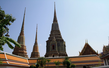 Bangkok, Thailand, Wat Pho temple complex. Buddhist stupas and architectural details.