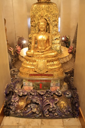 Bangkok Thailand. Statue of a seated Buddha in the Golden temple, Srakesa temple.