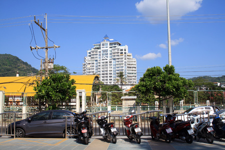 Phuket, Patong beach, Thailand. View of Tower Patong hotel and the street with motorcycles and cars.