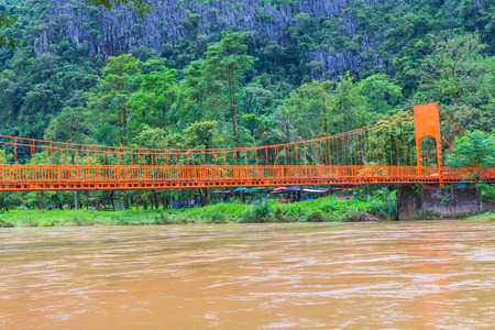 orange bridge over the river at Vang Vieng