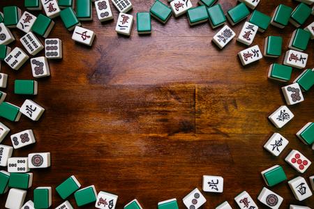 Full of Mahjong tiles on wood table background