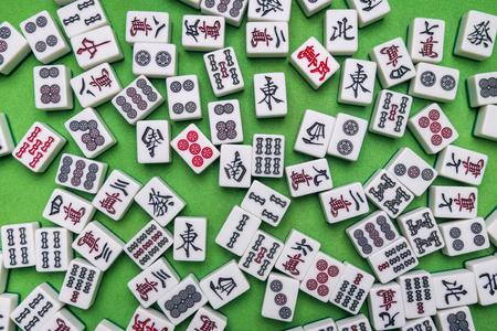 Full of Mahjong tiles the chinese korea japanese game on Green background