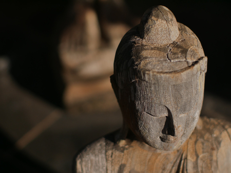 Face of Buddha statue  made from wood for pray meditation and spirituality Stock Photo