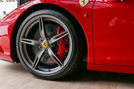 close up of Red Ferrari F430 Scuderia Front Wheel brake system with logotype. at Bangkok, Thailand, July 2017 ; editorial use only Editorial