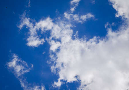 clear blue sky background with clouds