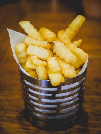tradition: Tasty and delicious french fries in small bucket. fastfood. Stock Photo
