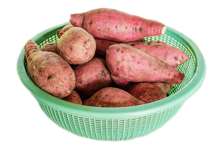 yam in basket isolate backgruond Stock Photo