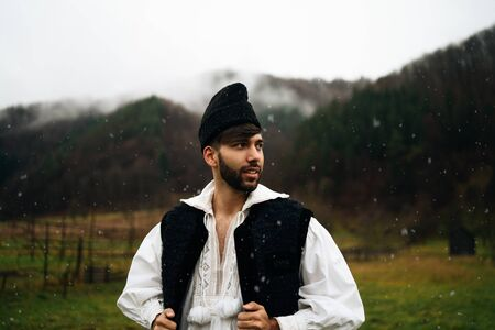 Young man dressed in traditional outfit of northern Romania, Maramures Stock fotó
