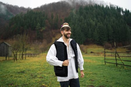Young man dressed in traditional outfit of northern Romania, Maramures Foto de archivo