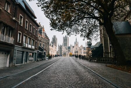 Beautiful medieval city of Ghent with Gothic cathedral in the background