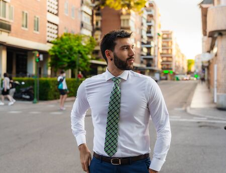 Young business man with white shirt and tie in outdoor city
