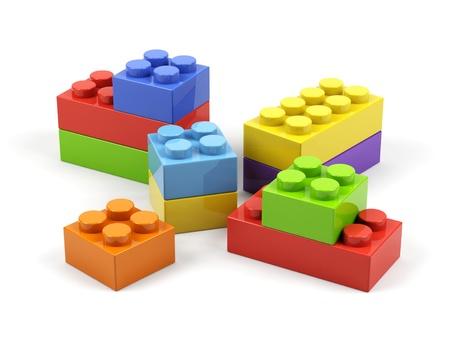 Plastic toy blocks on white background  Stockfoto