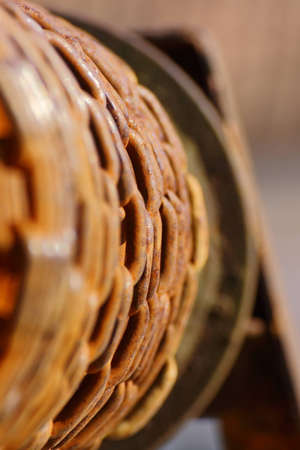 platen: Chain twisted on a platen using for pouring water from the fountain Stock Photo