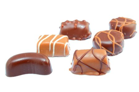 diversify: six different types of chocolate candies isolated on white