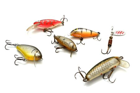 collection of small fishing lures over white background photo