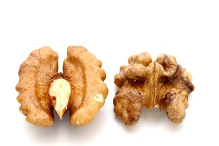 two facets of walnut kernel over white background photo