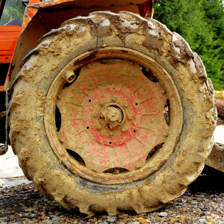muddy tracks: dirty tractor wheel after working in the muddy tracks of the forest Stock Photo