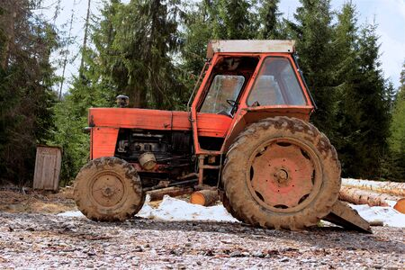 old tractor in the mountain woods used by saw dust eaters photo