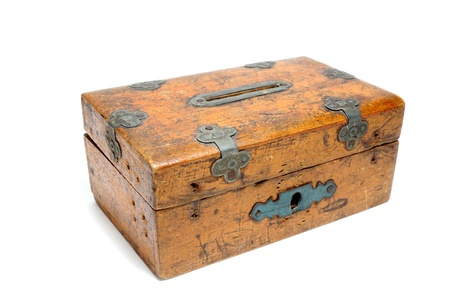 moneybox: very old wooden moneybox over white background