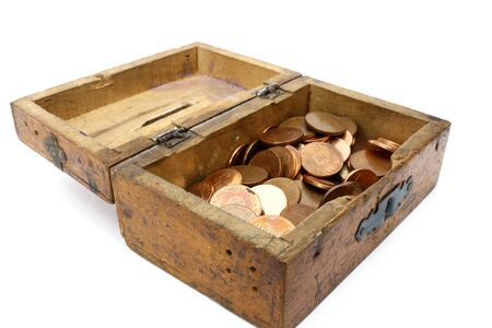 moneybox: vintage wooden moneybox filled with romanian coins Stock Photo