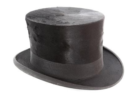 白い背景の上の非常に古いトッパー帽子 写真素材