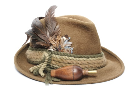 top: hunting gear - old traditional wool hat and game call for foxes