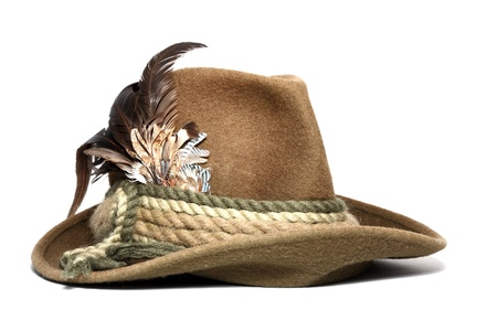 vintage woolen hunting hat decorated with feathers over white background 스톡 콘텐츠