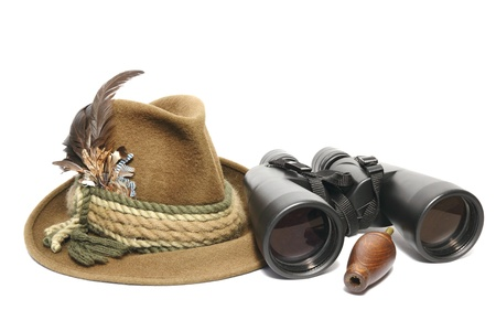 hunting equipment - hat, binoculars and game call for foxes Stock Photo