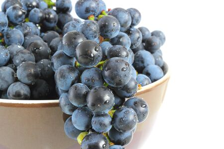 wet red grapes in brown bowl photo