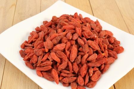 goji: bunch of goji berries on a white plate