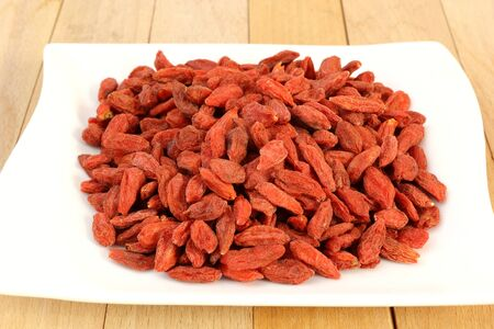 lycii: red goji fruits over white plate