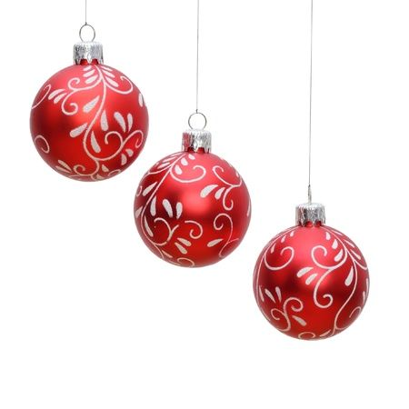 christmas baubles: three hanging red christmas balls isolated over white background