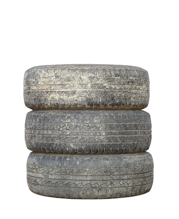 three dirty used tires isolated over white background photo
