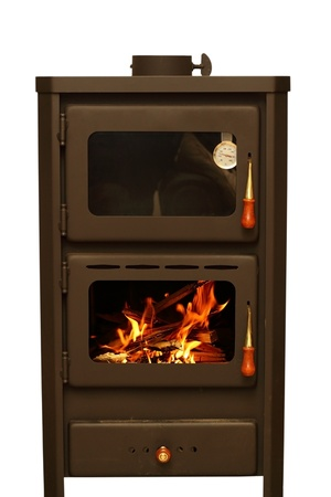 oven with wood ready for fire isolated over white background Standard-Bild