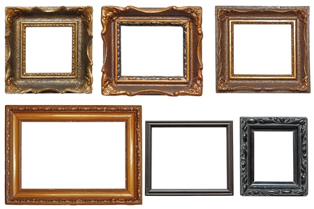 collection of beautiful old wooden frames for paintings isolated on white background photo