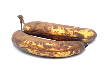 bad banana: two old dried bananas over white background