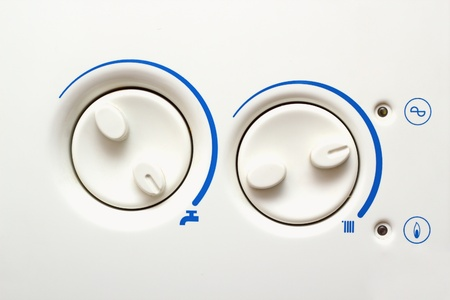 mini oven: detail of buttons of an old household heating appliance