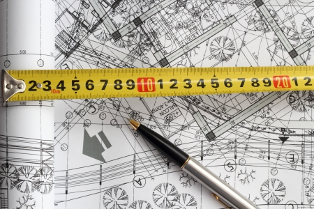 measurement tape: engineering instruments - pencil and measurement tape -over background from sketches on white paper
