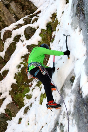 mountaineer beginning the ascent on a big wall in winter photo