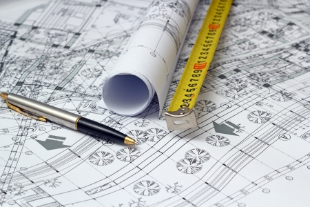 construction plans: architectural sketches printed on white paper and drawing instruments Stock Photo