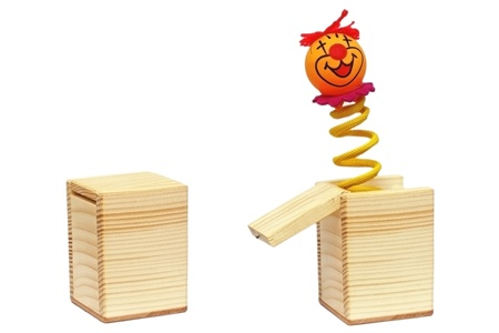 tricky toy with clown on spring coming out from a wooden box
