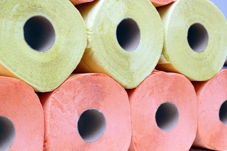 stack of yellow and pink recycled toilet paper photo