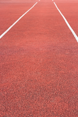 perspective of cinder running track at the sport stadium photo