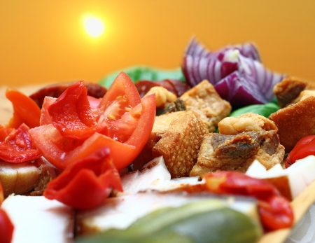 romanian traditional appetizer with pork meat, onion and fresh tomato
